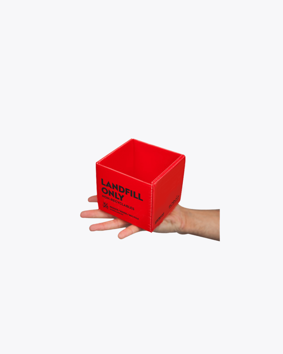 Red cube on hand